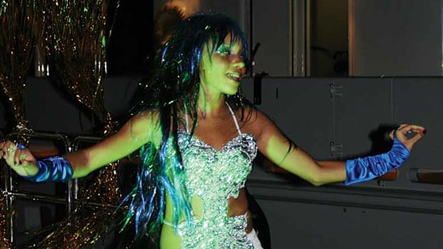 A professional dancer shakes to the music onboard Harmony.