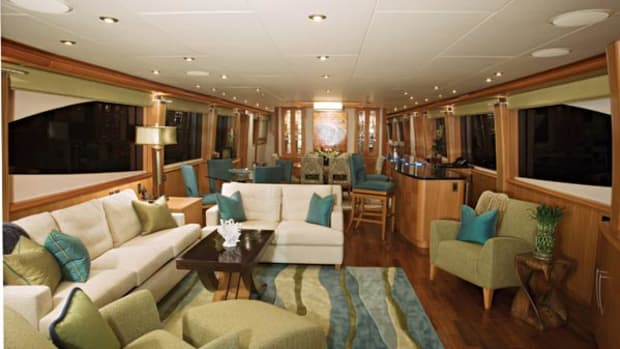 Pecan paneling and a partition-free layout make the spacious main deck seem beamier - and, even better, make it easy for Pam Heatley to get around.