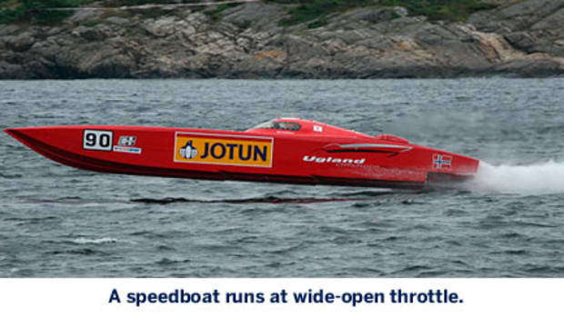 A speedboat runs at wide-open throttle.