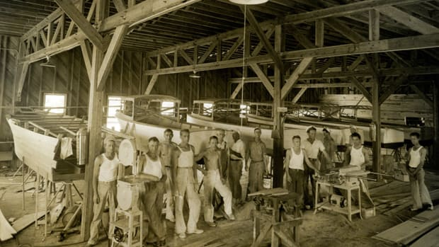 Workers gather in the woodshop at Johnson's facility on the Miami River