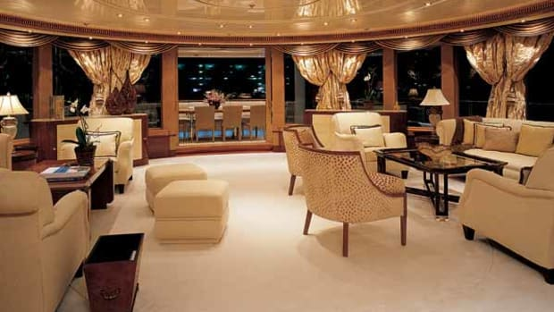 The curved wall of windows aft in the yacht's saloon make for drama day or night.
