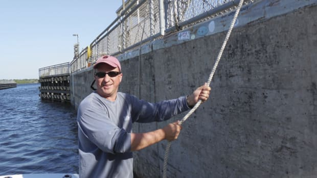 George Sass tends a lock on the Okeechobee Waterway.