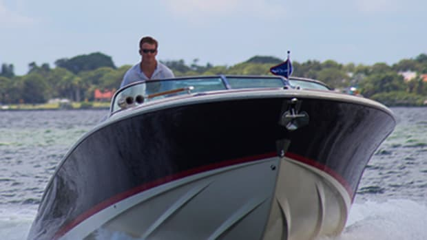 Dan Harding driving a Chris-Craft. Photo by John V Turner