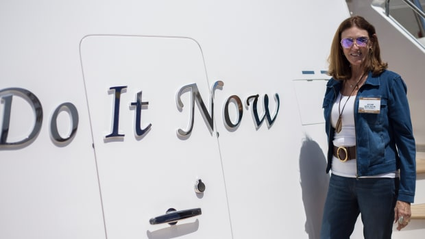 "Jo Ellard and her yacht ""Do it Now"""