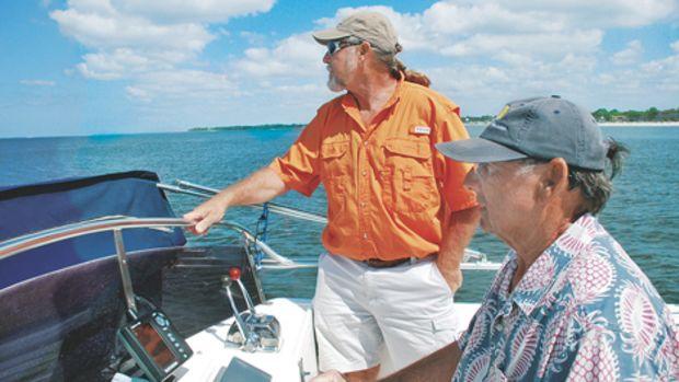 Guillard (in the orange shirt) and Whitney in their native habitat.