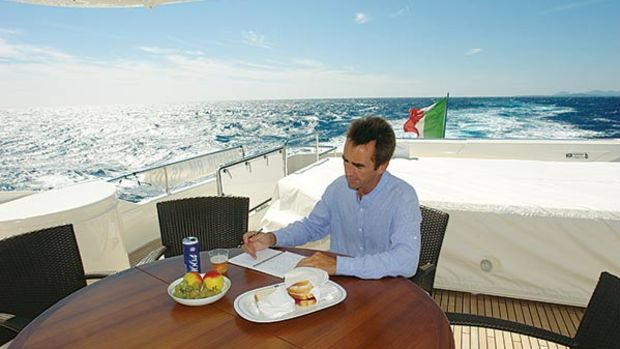 """The author tests the yacht's stability using the old """"can of beer"""" technique."""
