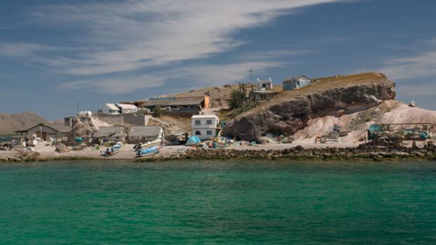 Isla Coyote, an islet where some 30 Mexican fishermen somehow manage to live in peace and harmony.