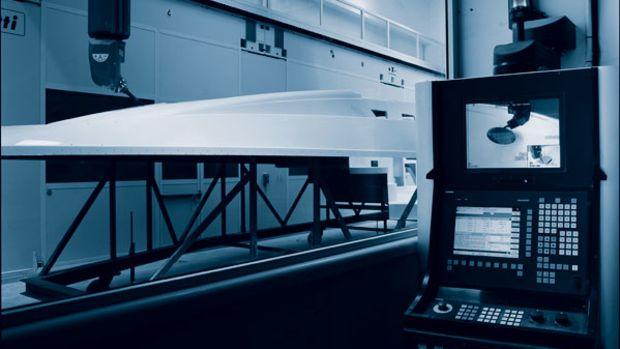 A machine mills deck components at Azimut.