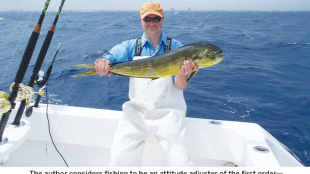 Jason Y. Wood and a mahi-mahi