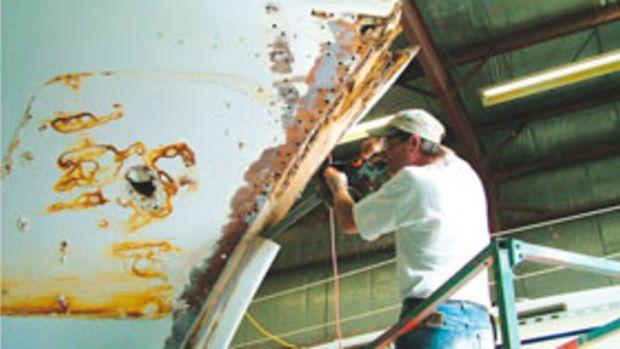 Repairing a boat at Oxford Boatyard, in Oxford, Maryland