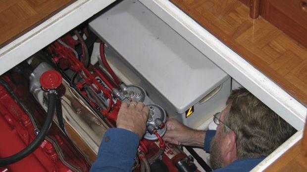 Bill Pike working on Betty Jane's engine