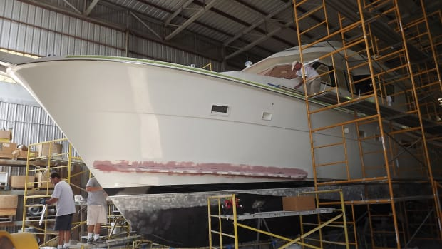 Here's a nice little refit. Check out the sprayrails at the bow, just above the bootstripe. Vinyl rails often crack with age. You can either refurbish or replace.