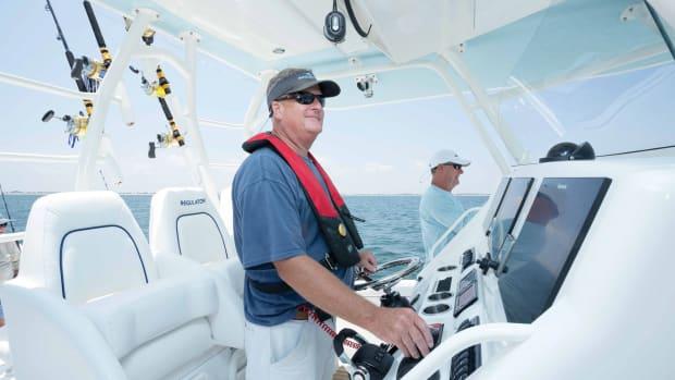 Capt. at helm