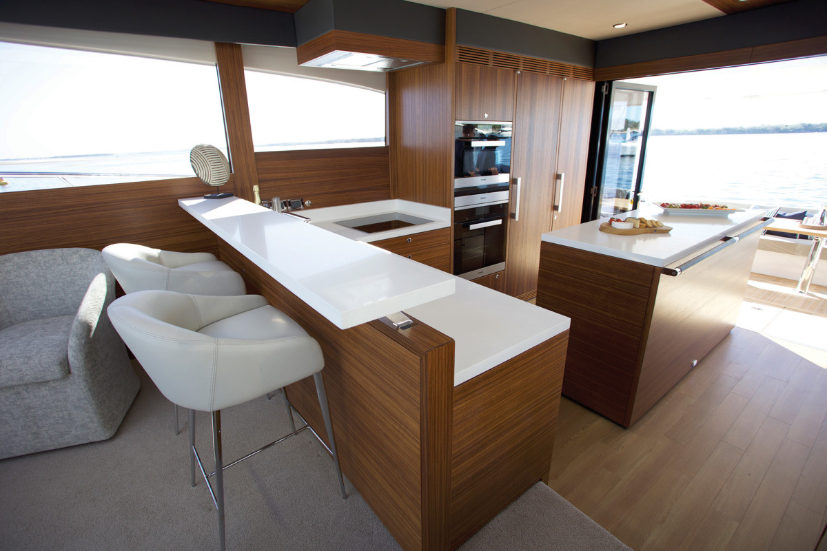 The island in the galley not only offers counter space for meal prep, but additional stowage for longer cruises.