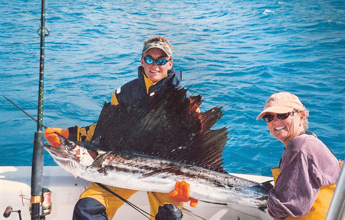 Ben Brownlee, the author's son, with a sailfish caught by his mother, Poppy, off Alligator Reef.