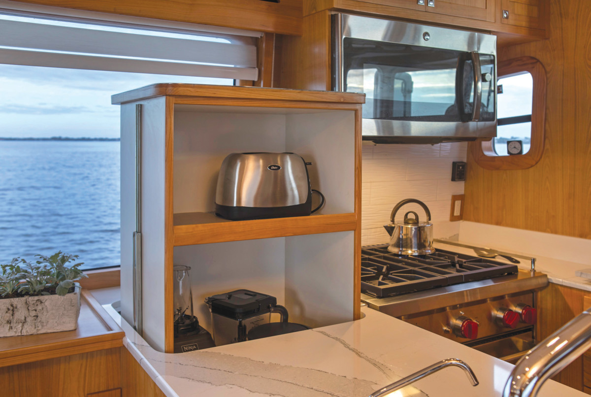 An electric lift is a creative stowage solution in the galley.