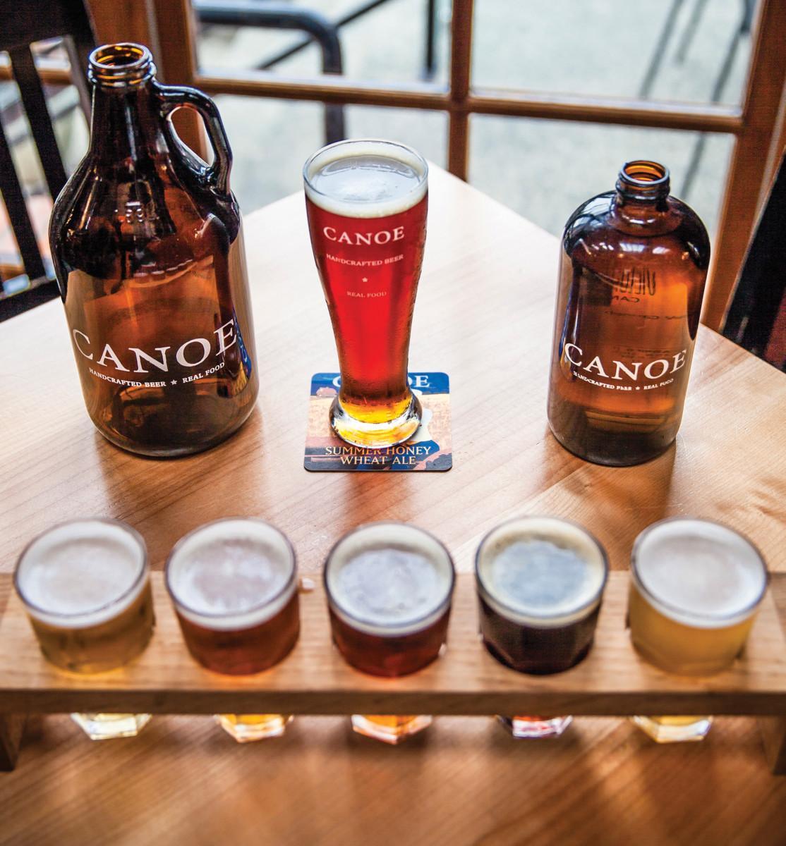 Spirits are mixed at a craft brew pub.