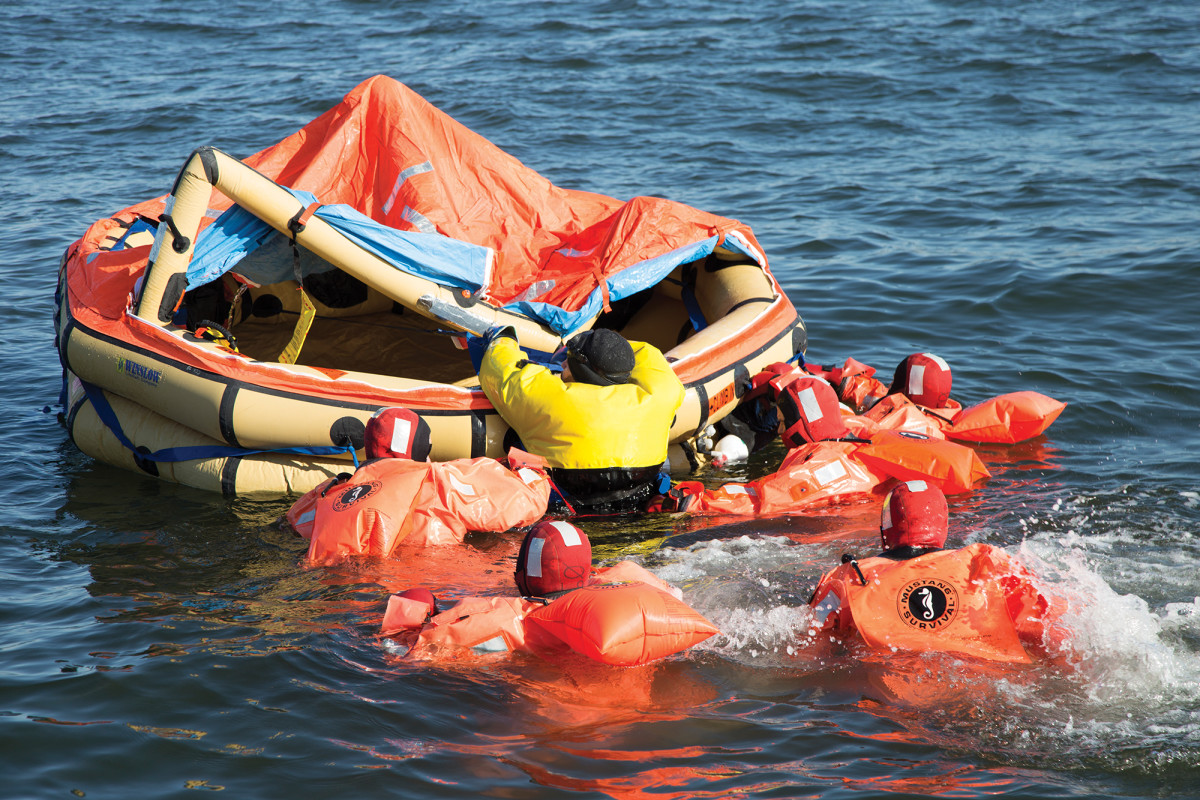 Entering a liferaft in a survival suit is no easy task