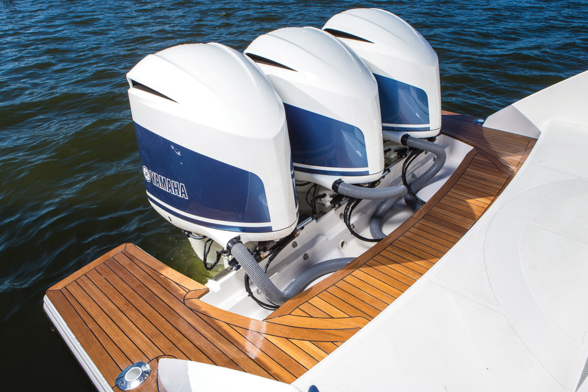 A trio of Yamaha F350s push the 38 LS to 49 knots at wide-open throttle.