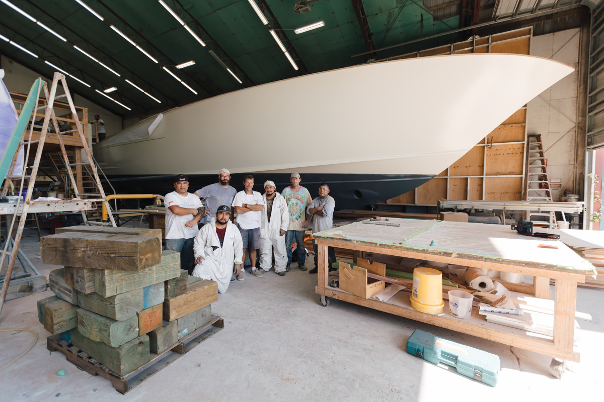 The hull crew (Orlando, Matt, Wayne, Santiago, Larry, Dilmar and Adolfo) builds the hull, flips it over and does most of the belowdecks construction.