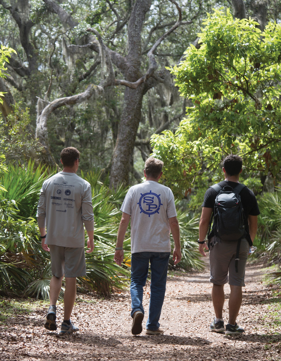 The crew heads toward adventure in the live oak forest.