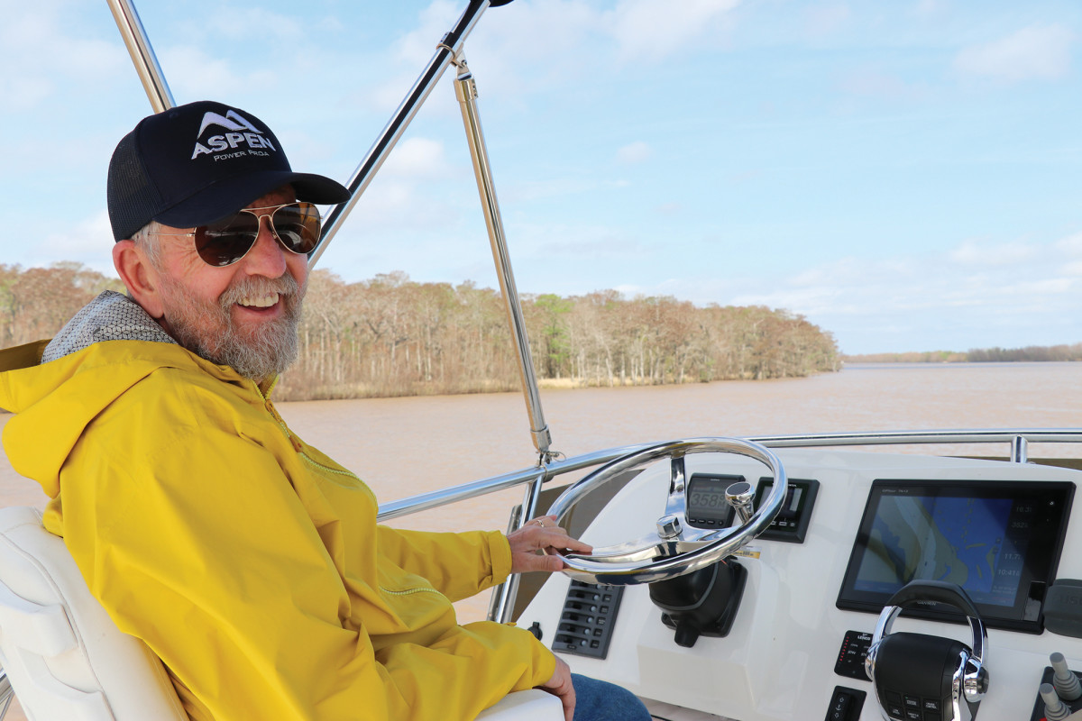 The author at the helm during a speedy transit of Southern Louisiana's Bayou Chene.