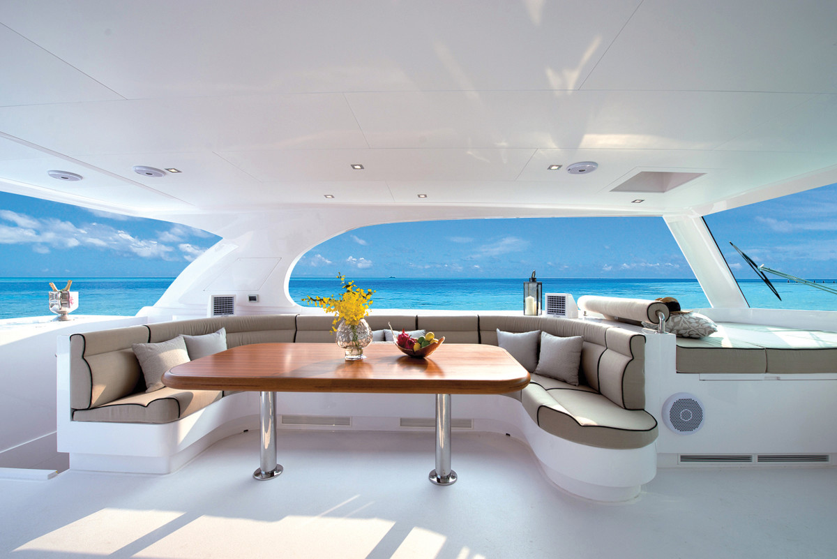 The dining area on the flybridge seats 10 passengers in climate-controlled comfort.