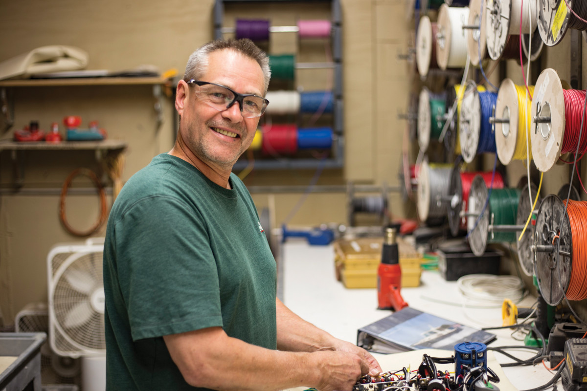 A 25-year veteran, Tim Lorrain hustles about in the electrical shop