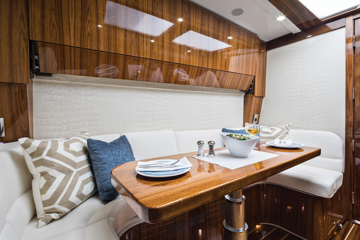 A hidden Pullman berth above the settee allows the 65 to sleep a total of five.