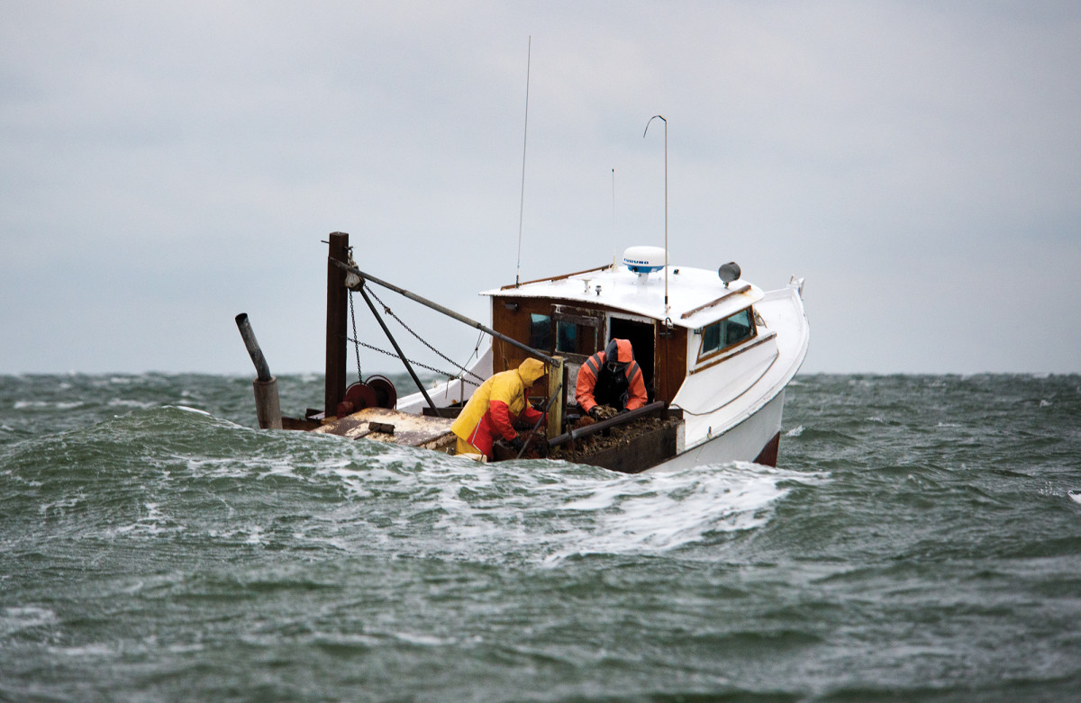 Fishermen battle building seas.