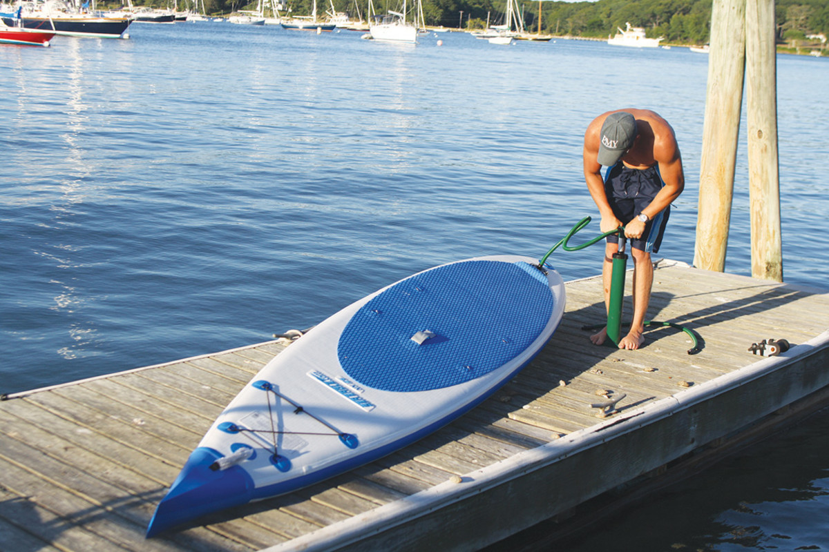 Blowing up an inflatable paddleboard