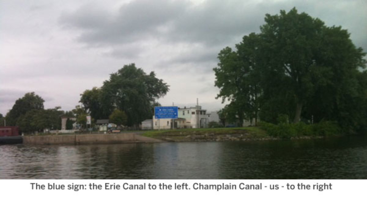 The blue sign: the Erie Canal to the left. Champlain Canal - us - to the right