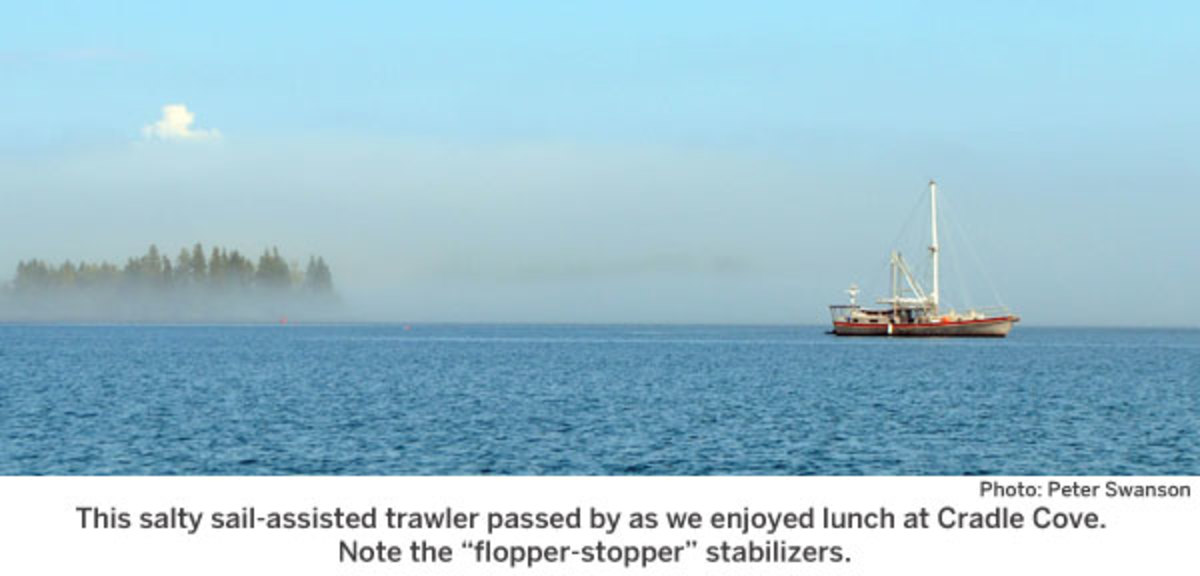 This salty sail-assisted trawler passed by as we enjoyed lunch at Cradle Cove.