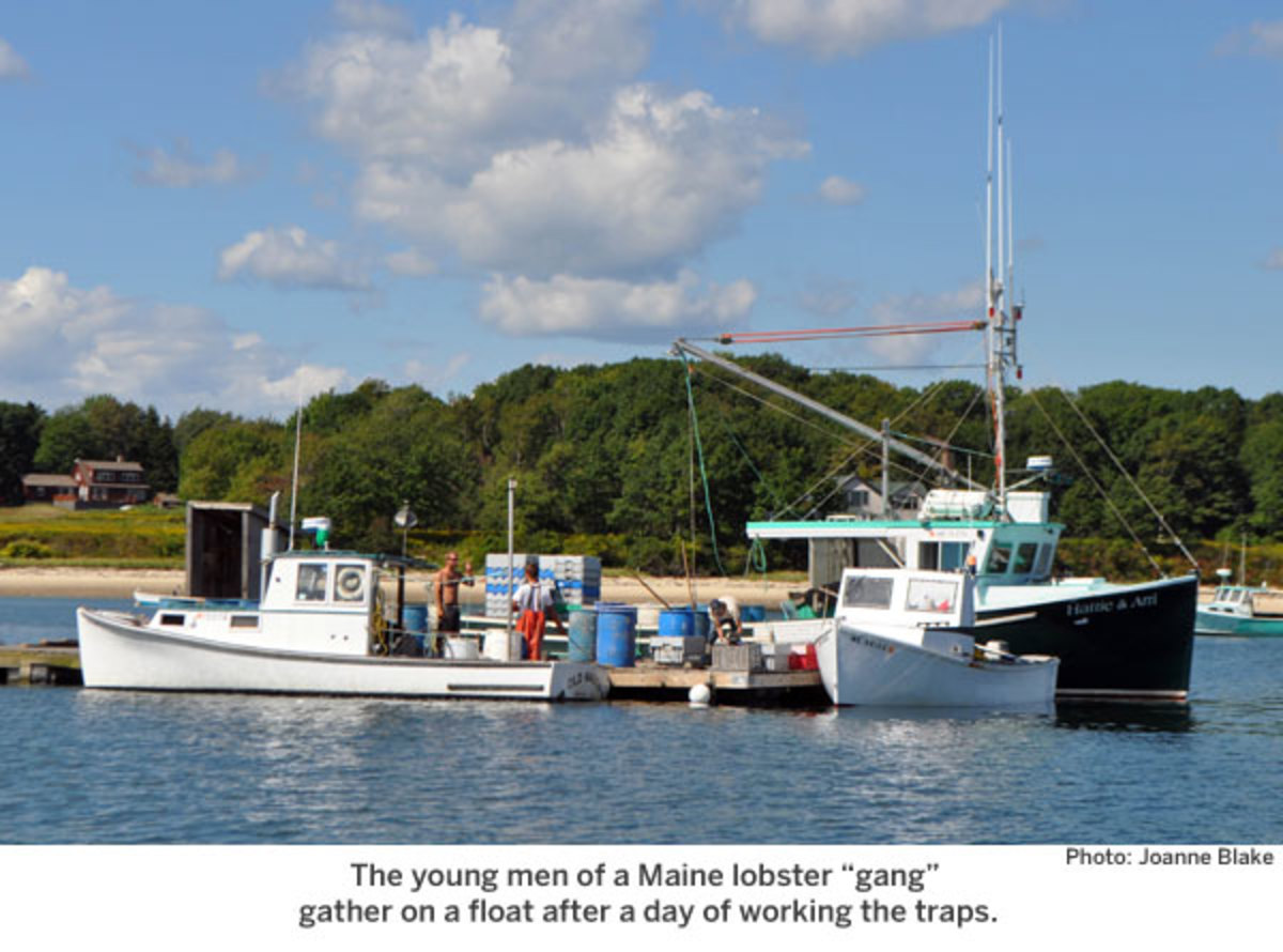 "The young men of a Maine lobster ""gang"" gather on a float after a day of working the traps."