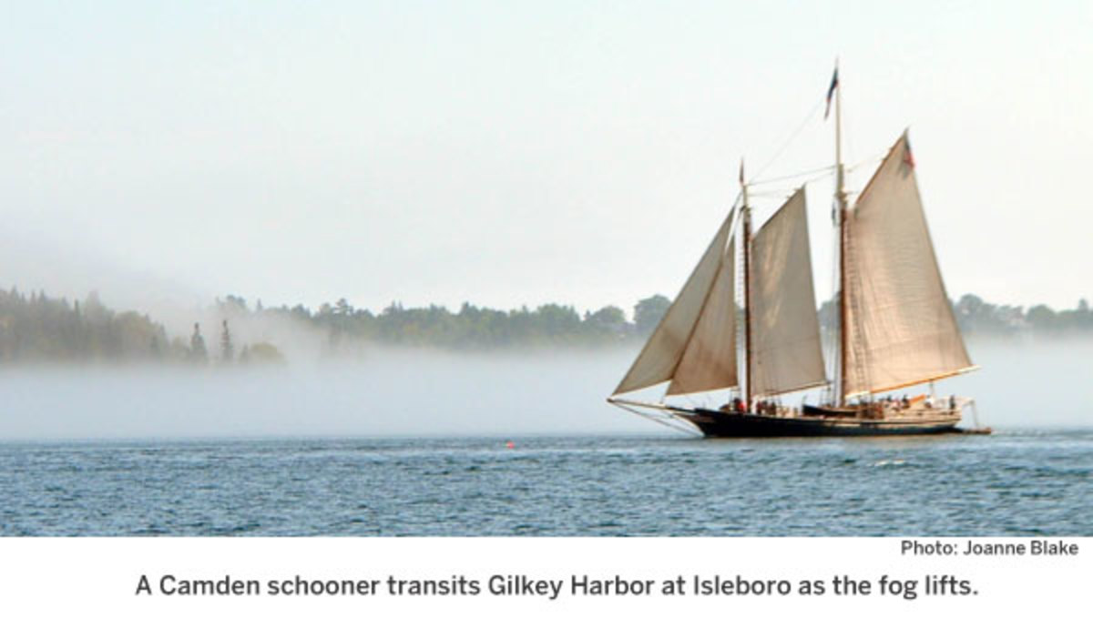 A Camden schooner transits Gilkey Harbor at Isleboro as the fog lifts.
