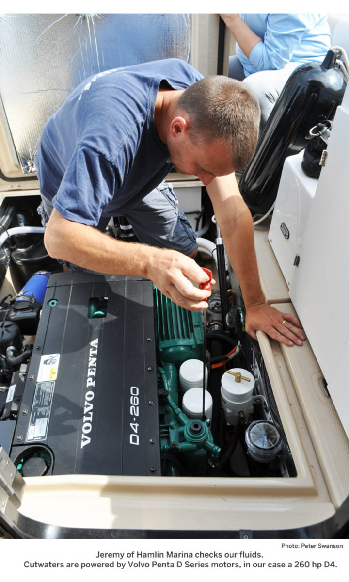 Jeremy of Hamlin Marina checks our fluids. Cutwaters are powered by Volvo Penta D Series motors, in our case a 260 hp D4.