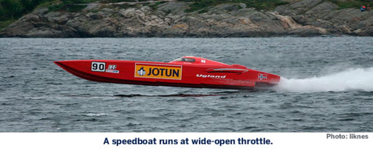 A speedboat runs at wide-open throttle.