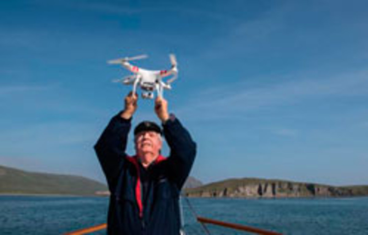 Tony Fleming prepares to launch his drone