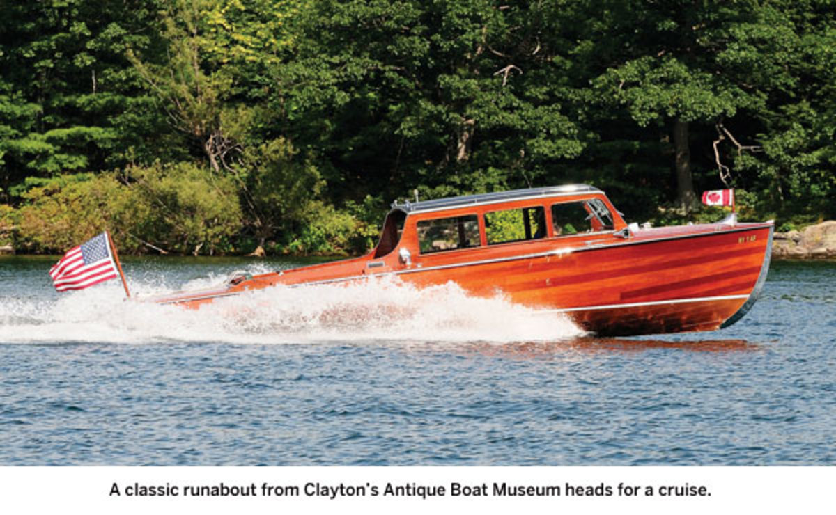 A classic runabout from Clayton's Antique Boat Museum heads for a cruise.