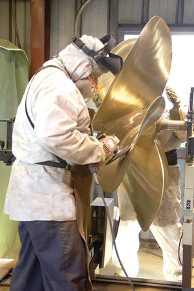 A technician fairs a propeller at Bradford Marine in Ft. Lauderdale.