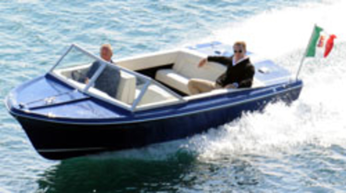 Dainel Craig as James Bond being driven by Sunseeker managing director Robert Braithwaite, CBE