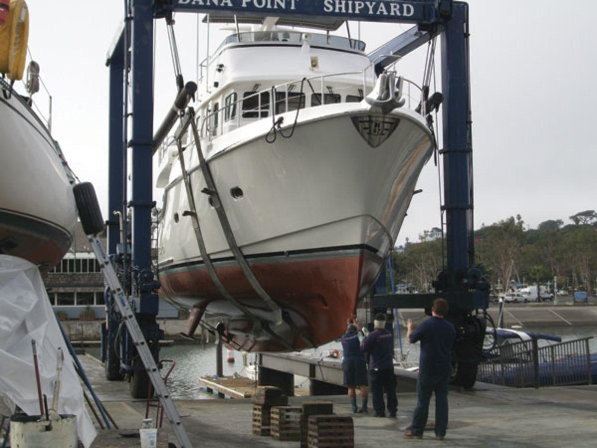 A Nordhavn 47 gets ready to splash at Dana Point Shipyard, Inc., in Dana  Point, California.