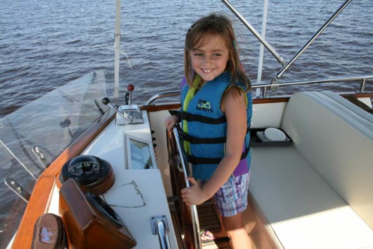 little girl at helm of Betty Jane