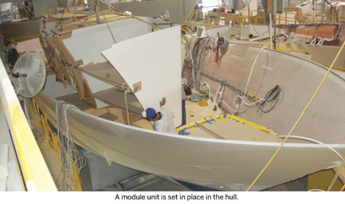 A module unit is set in place in the hull.