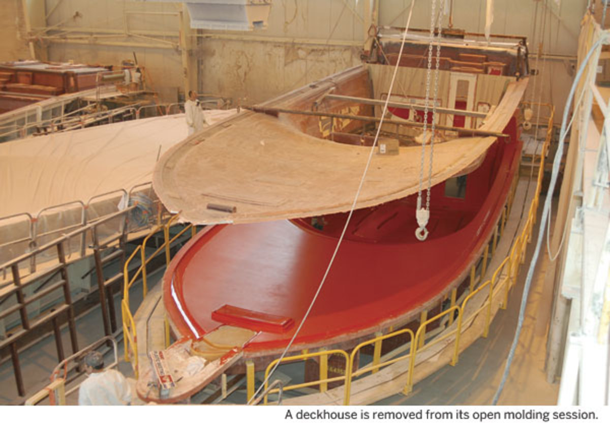 A deckhouse is removed from its open molding session.
