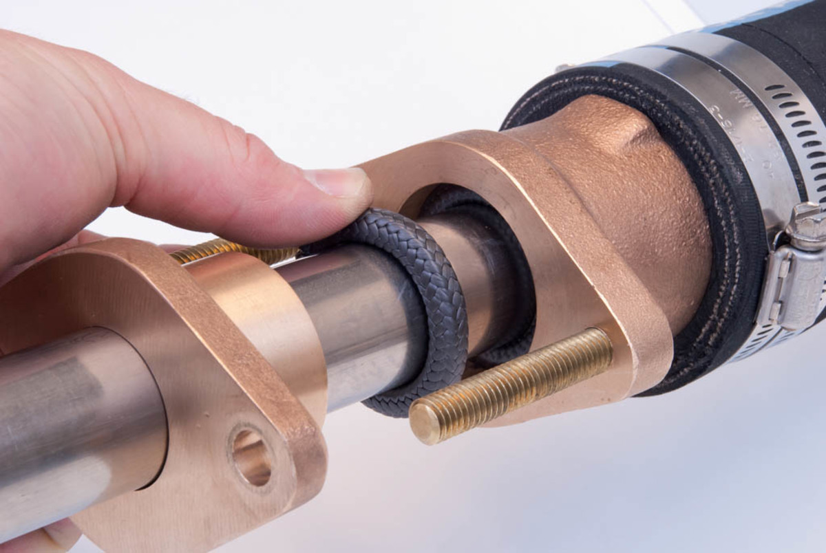 A spud-type stuffing box is threaded with one large nut that contains the packing.