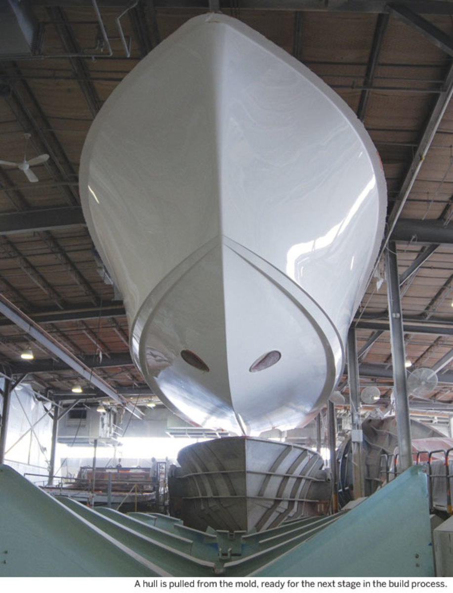 A hull is pulled from the mold, ready for the next stage in the build process.