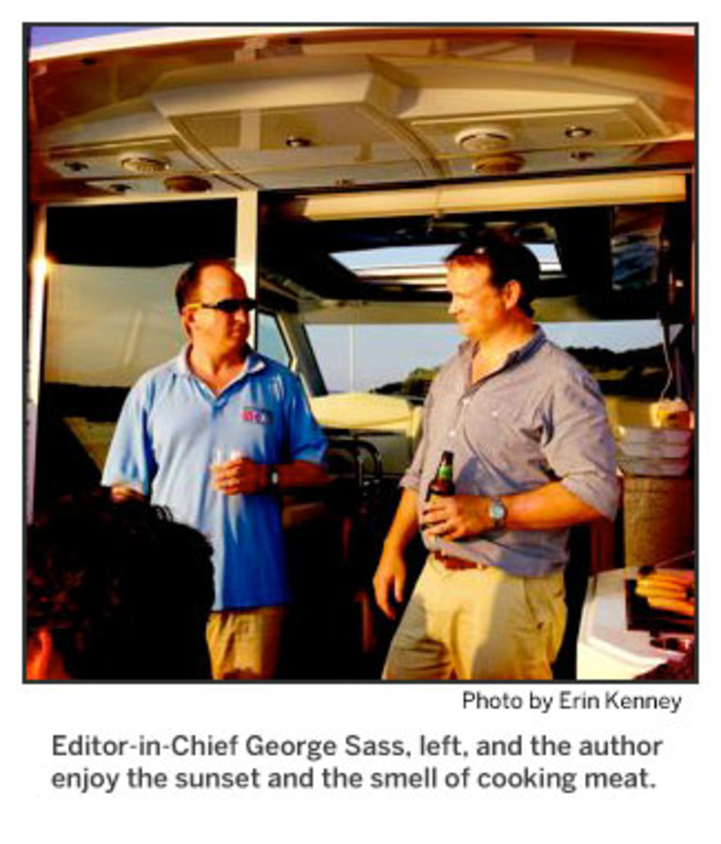 Editor-in-Chief George Sass, left, and the author enjoy the sunset and the smell of cooking meat. Photo by Erin Kenney