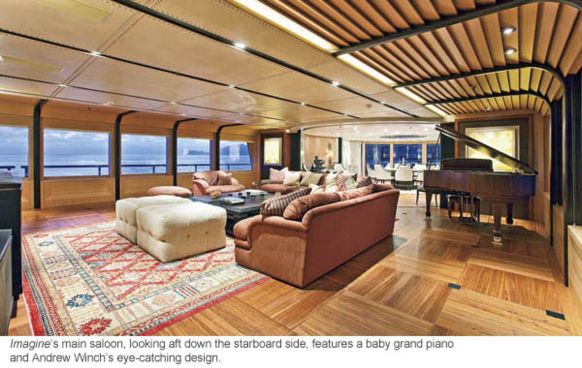 Imagine's main saloon, looking aft down the starboard side, features a baby grand piano and Andrew Winch's eye-catching design.