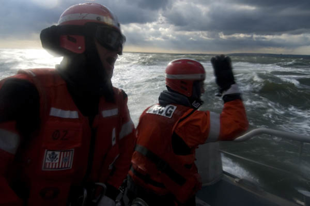Members of Coast Guard Station Sandy Hook, New Jersey, call out directions during a heavy-weather man-overboard drill off the coast of New Jersey on January 8, 2009. Photograph taken by Petty Officer Seth Johnson.